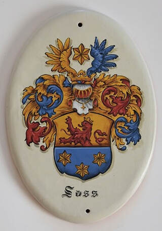 Family crest painting on hand crafted ceramic tiles