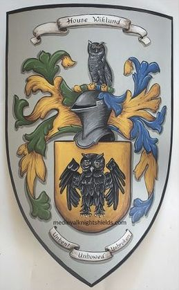 Metal knight shield w. owl